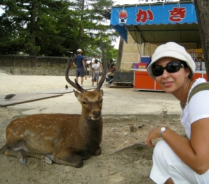 """Nazgol-- an animal rights activist on her """"free time""""--enjoying the peaceful relationship between human and deer in Nara Park, Japan. She believes Japanese society provides her with an excellent context for studying gender relations.  """"…Japan is a very interesting mixture of modern and traditional...In terms of material culture, it has become modern and western, however, in terms of ideology, it still follows the traditional gender hierarchy and roles."""""""